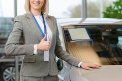 Saleswoman representing a vehicle - stock photo