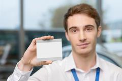 Young man showing his brand new driving ticket Stock Photos