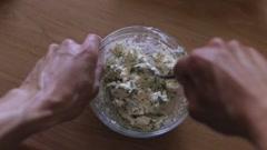 Stock Video Footage of Man preparing stuffing salty