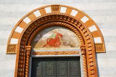 Church door   in italy  lombardy   jesus Stock Photos