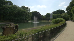 Water Tower next to a lake in the Saxon Garden in Warsaw Stock Footage