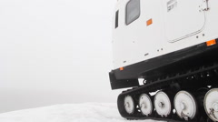 Snowcat over ice with fog, dolly camera Stock Footage