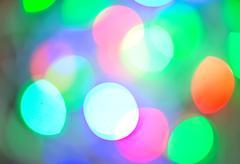 Background of defocussed color lights with sparkles Kuvituskuvat