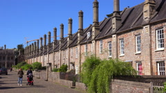 Beautiful old English row houses line the streets of Wells, England. - stock footage