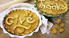 Homemade pumpkin pies with Give Thanks sign and Autumn stamped leafs. - stock footage