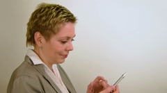 Pretty short hair business woman texting message Stock Footage