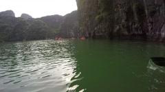 pov Adventurous View Of Kayak Remote Lake 4k ha long bay vietnam paradise beach - stock footage