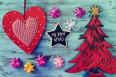 christmas ornaments and text merry xmas in a star-shaped chalkboard - stock photo