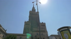 Sun shining above Palac Kultury i Nauki in plac Defilad, Warsaw Stock Footage