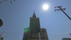 Sun shining above the Palace of Culture and Science, abbreviated PKiN, in Warsaw Stock Footage