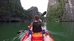 attractive woman sport Kayak 4k ha long bay vietnam paradise tropical holidays - stock footage