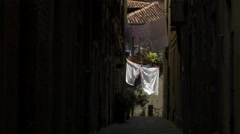 White and pink clothes drying on ropes on a street in Venice Stock Footage