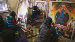 students paints a mantra in the local school in the Bhaktapur, Nepal - stock footage
