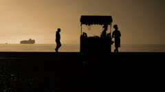 Tranquility Cinematic Slow Motion scene of Silhouettes of ordinary People Stock Footage