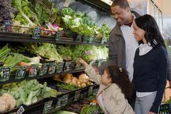 A family shopping in a supermarket Stock Photos