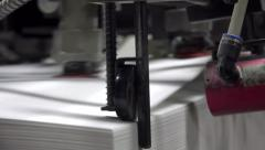 Print sheets are loaded in commercial offset printing press machine. UHD stea Stock Footage