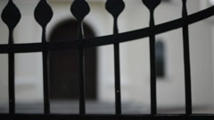 Metal lattice gates at Church in Nowogrod, Poland - stock footage