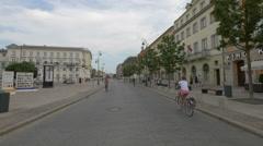 Riding bikes on Krakowskie Przedmiescie street in Warsaw Stock Footage