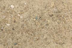 Sand and dusty surface with small stones - stock photo