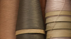 Right Panning Shot Across Reels of Yarn Stock Footage