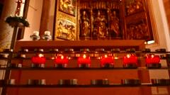 Candles burn in the Catholic Parish Church of Hallstatt Stock Footage