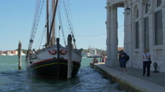 View of an old sailing boat anchored near Punta della Dogana di Mare in Venice Stock Footage