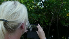 European woman takes pictures with mobile Stock Footage