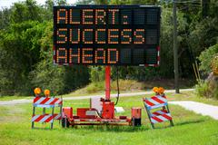 Alert: Success Ahead Lighted Road Sign Stock Photos