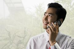 Young businessman using a cellular telephone Stock Photos