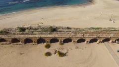 Stock Video Footage of Caesarea aqueduct, Israel.- Aerial footage
