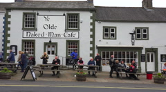 An establishing shot of Ye Olde Naked Man pub and bar in Settle, Yorkshire, Stock Footage