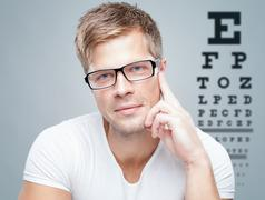Handsome man wearing glasses Stock Photos