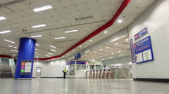 A low angle pan right to left time lapse of people walking out of ticketing area - stock footage