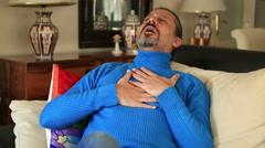 Man having heart attack Stock Footage