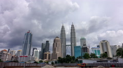 A cloudscape time lapse at Petronas Twin Towers during day time. - stock footage
