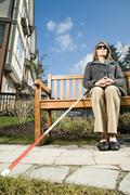 Blind woman sitting on a bench Stock Photos