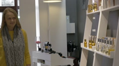 Man and Woman by the Shelf with Perfumery Stock Footage