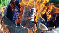 Stock Video Footage of Closeup view of a bonfire flames and burning firewood