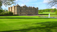 Establishing shot of the Longleat mansion in England amidst green lawns and Stock Footage