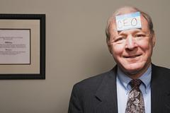 Mature businessman achieving success - stock photo