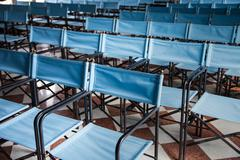 Composition of blue canvas folding chairs Stock Photos