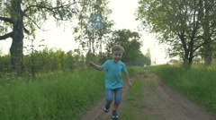 Boy Running with Scoop-Net Stock Footage