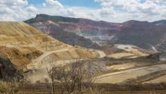 Live action panning shot across a huge open pit quarry mine Stock Footage