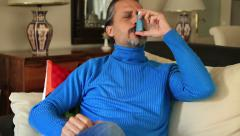 Mid adult man using asthma inhaler 2 Stock Footage