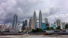 A cloudscape time lapse at Petronas Twin Towers during day time. Stock Footage
