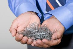 Office worker with paperclips Stock Photos