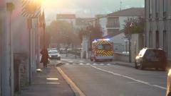 Emergency vehicle park in street, revolving light on - Zoom out Stock Footage