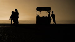 Tranquility Cinematic Slow Motion scene of Silhouettes of ordinary People - stock footage