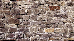 Movement along wall of bricks Stock Footage