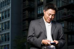Man using handheld computer - stock photo
